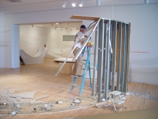 Walls come down during the de-installation of Materials & Meanings.