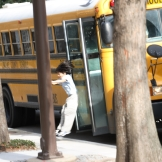 An excited 4th grader hops off the bus