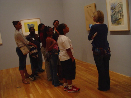 Docents led families in a brief tour of the Flower of the Prairie: George Grosz exhibition.