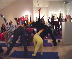 Families enjoy yoga in the galleries