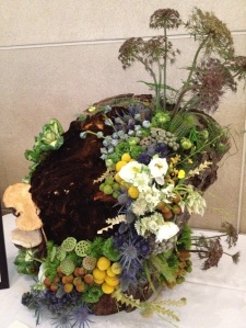 Floral arrangement inspired by Victor Higgins' A Mountain Ceremony in the DMA's collection