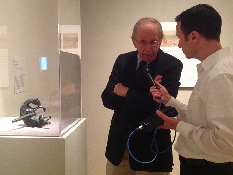 Artist Jack Zajac discussing his sculpture, Small Bound Goat, with KERA's Stephen Becker at the opening of Hotel Texas in May 2013.