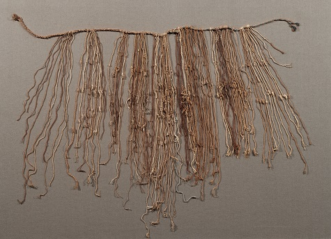 Fragmentary khipu with two main cords and top and subsidiary and tertiary cords, Inca, Late Horizon, c. A.D. 1476-1534, cotton, plant fiber, and indigo dye, Dallas Museum of Art, the Nora and John Wise Collection, bequest of John Wise