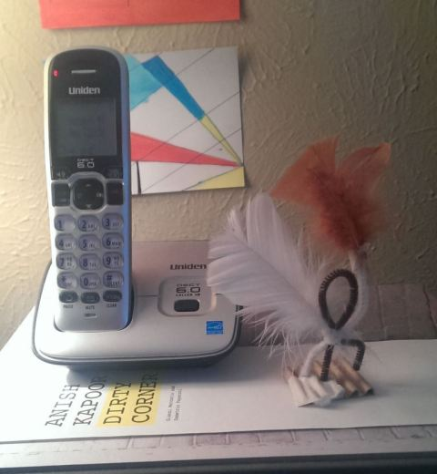 A trinket left by a visitor that I keep by my phone to remind me to be receptive (yes, I still use a home phone)