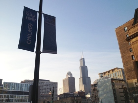 CAA welcome banner with the emblematic Willis (Sears) Tower in the background.