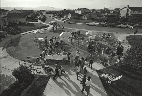 Bill Owens, This is our second annual Fourth of July block party. This year thirty-three families came for beer, barbequed chicken, corn on the cob, potato salad, green salad, macaroni salad, and watermelon. After eating and drinking we staged our parade and fireworks., 1971, gelatin silver print, Dallas Museum of Art, Lay Family Acquisition Fund