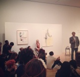 Students speak with artist Stephen Lapthisophon about his special exhibitions.