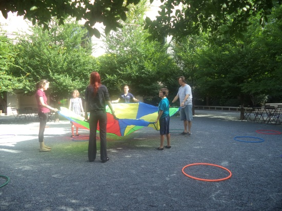 Play time with hula hoops, streamers, and parachutes in the courtyard