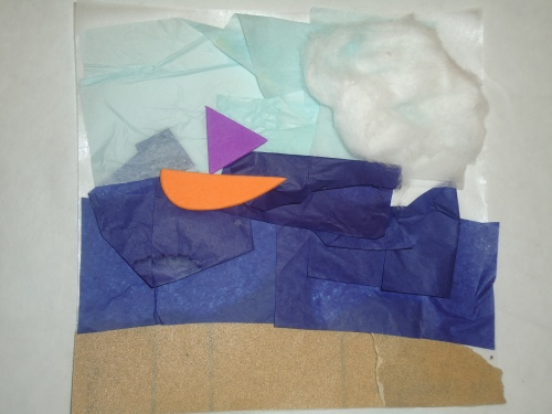 Beach scene created with sand paper, tissue paper, cotton balls, and foam shapes