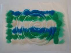 Sprinkle sand onto contact paper, then draw directly on top of it