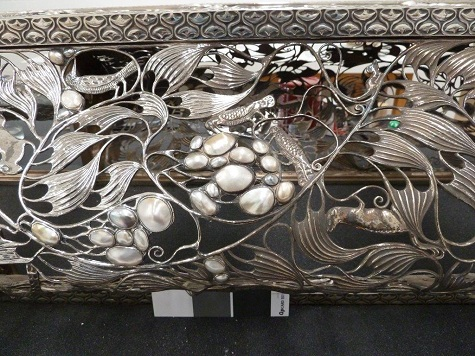 During removal of silver tarnish, as seen in this image from left to right.