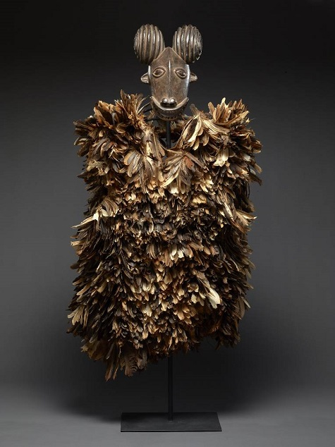 Helmet mask with feather costume, Kom peoples, North West Province, Cameroon, Africa, Early to mid-20th century, wood, fibers, and feathers, Dallas Museum of Art, African Collection Fund