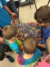 John sharing his artwork with kids in the homeschool class