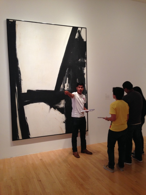 Group of students in the Hoffman Gallery discussing Contemporary Art.