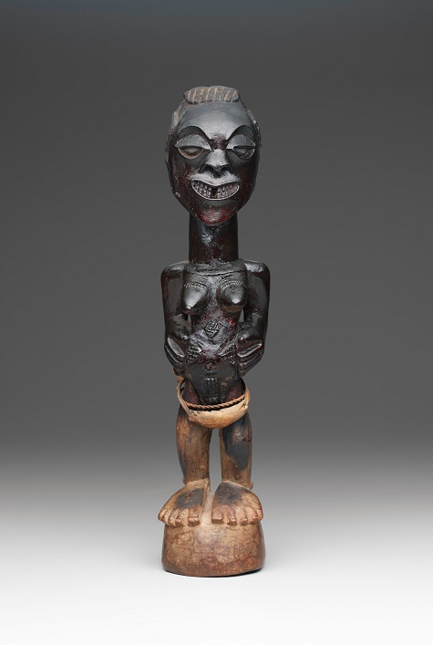 Standing female power figure (nkishi), late 19th to early 20th century, Songye peoples, Democratic Republic of the Congo, Africa, wood, skin, cord, and metal, Dallas Museum of Art, The Clark and Frances Stillman Collection of Congo Sculpture, gift of Eugene and Margaret McDermott