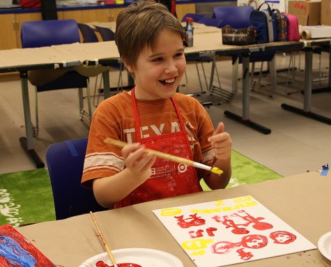 Rachel's son attending Hands-On Summer Art Camp for Children with Autism at the DMA