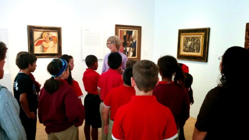 DMA Docent Carolyn Harris captivates a group of fourth graders during a school visit.