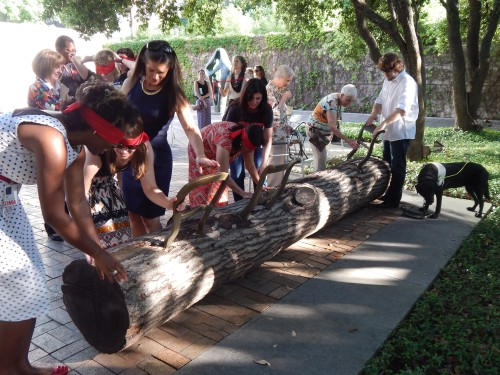 "Blind-folded touch-tour attendees experience Jurgen Bey's ""Tree-Trunk Bench"" (1999) in our Sculpture Garden."
