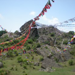 Prayer flags decorating sacred sites in the Himalayan foothills.