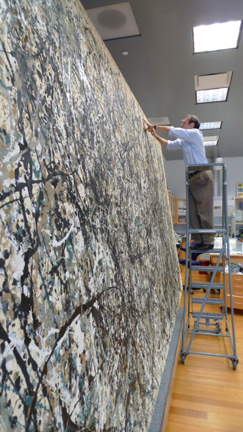 Jim Coddington at work on Jackson Pollock's One: Number 31, 1950 in the Conservation Studio at MoMA