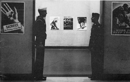 Two service men at an exhibition of war posters