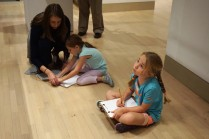 Sketching ideas in the galleries. (Passion for Fashion for ages 6-8).