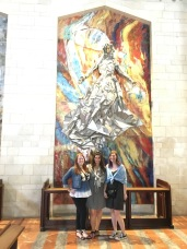 Madeleine and her friends at the Basilica of the Annunciation with the US's mosaic. Each country has one!