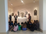 Mary Jo Milbank introducing her students to Shiva Nataraja, 11th century.