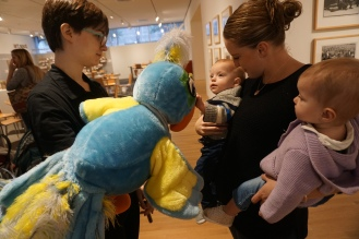 Some of our littlest family members meet our bluest family member, Arturo.
